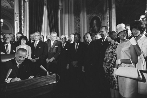 Photograph of President Lyndon Johnson Signs the Voting Rights Act as Martin Luther King, Jr., with Other Civil Rights Leaders in the Capitol Rotunda, Washington, DC, 08/06/1965 From: Johnson White House Photographs